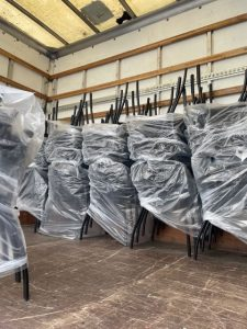Chairs being loaded for delivery