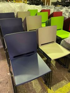 Colourful chairs in factory